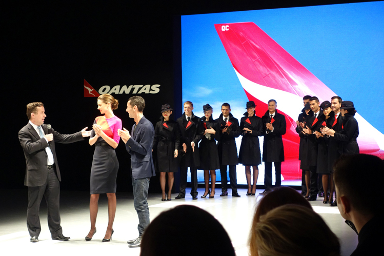 Qantas airways staff wearing official uniforms